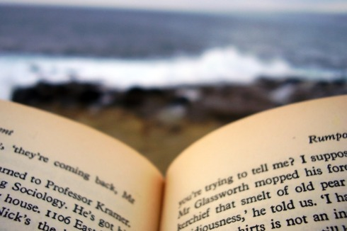 [Reading a book on the beach]